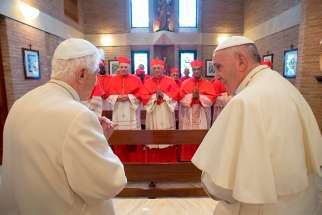 Pope Francis, right, and new cardinals visit with Pope Emeritus Benedict XVI at the retired pope's residence after a consistory at the Vatican Nov. 19, 2016.