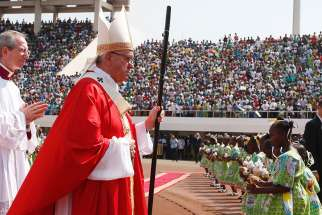 Pope Francis arrives in procession to celebrate Mass at Barthelemy Boganda Stadium in Bangui, Central African Republic, Nov. 30.