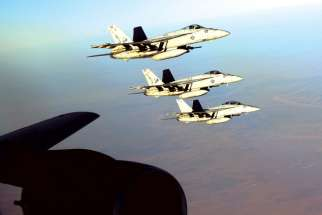 US Navy F-18E Super Hornets make a formation over northern Iraq before striking Islamic State targets in Syria. Canada is set to join in airstrikes against the Islamic State in Syria.