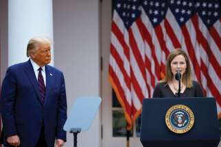 Amy Coney Barrett speaks after being introduced by President Donald Trump at the White House Sept. 26.