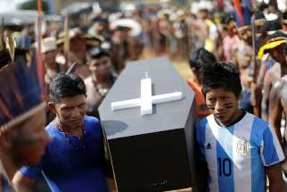 Brazilian Indians in Brasilia carry a symbolic coffin April 25 to show the death of indigenous rights in their country. The Brazilian bishops' Indigenous Missionary Council criticized an April 30 attack in a remote area of Maranhao state that left 13 Gamela Indians injured.