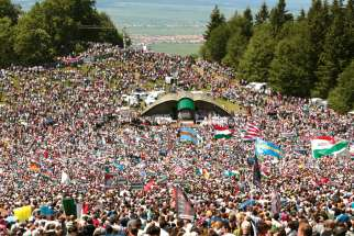 Pope Francis will visit the region's largest Marian shrine in Romania June 1, where an annual Pentecost Saturday pilgrimage draws thousands, mainly ethnic Hungarians, to Csíksomlyo (Hungarian) or Sumuleu Ciuc (Romanian) as seen in this 2018 photo.