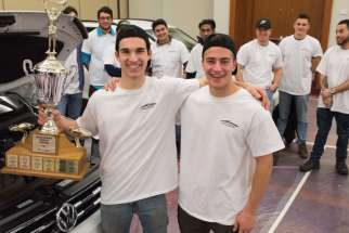 David Vecchiarelli, left, and Christopher Giuga show off the hardware they won at the Canadian International Auto Show.