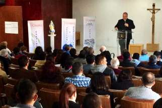 Fr. Philip Bochanski speaks to a crowd of about 100 Courage and EnCourage participants at the Courage-Latino conference in Mexico City in November last year.
