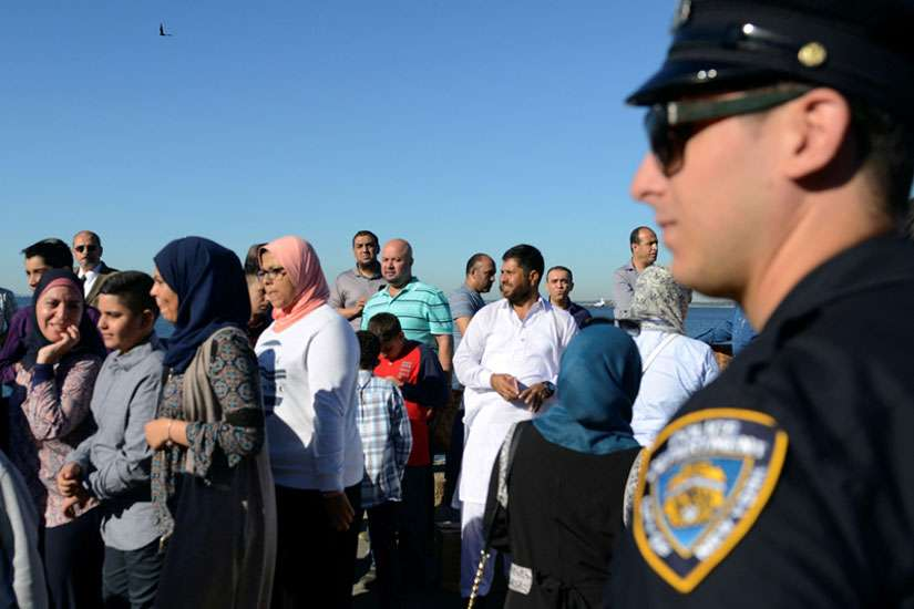 A member of the New York City Police Department stands guard during a group prayer session for the Muslim holiday Eid al-Adha in the Brooklyn borough of New York City on Aug. 12, 2016.