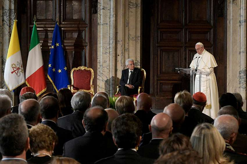 Pope Francis speaks alongside Italian President Sergio Mattarella during an official visit at Quirinal Palace in Rome June 10.