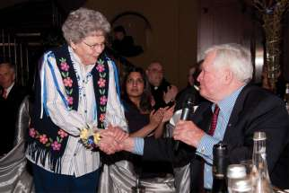 John Turner congratulates Sr. Bernadette Gautreau, who was presented with the St. Joseph Award during the Tastes of Heaven gala in 2011.