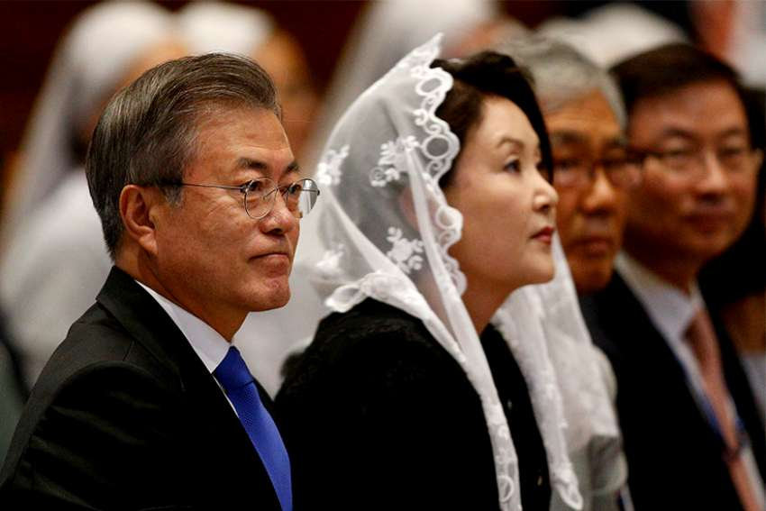 South Korean President Moon Jae-in, left, attends a Mass for peace for the Korean peninsula in St. Peter's Basilica at the Vatican Oct. 17. The Mass was celebrated by Cardinal Pietro Parolin, Vatican secretary of state.