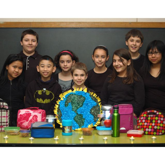"Students from various grades of St. Ambrose Catholic School show off their ""litterless lunches"", highlighted as part of Earth Hour 2012."