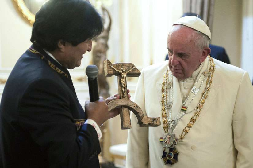 Bolivian President Evo Morales presents a gift to Pope Francis at the government palace in La Paz, Bolivia, July 8. The gift was a wooden hammer and sickle -- the symbol of communism -- with a figure of a crucified Christ.