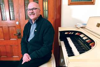 Organist Gordon Mansell has been helping keep alive the music of the late Msgr. John Ronan.