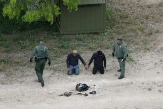 Border Patrol agents apprehend people who illegally crossed the border from Mexico into the U.S. in the Rio Grande Valley sector, near Falfurrias, Texas. U.S. President Donald Trump officially signed a memorandum April 4 to deploy the National Guard to the southwest border.