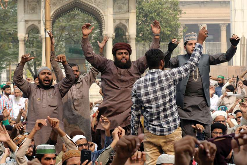 Men protest in Lahore, Pakistan, Oct. 31, after the Supreme Court acquitted Asia Bibi, a Catholic accused of blasphemy.