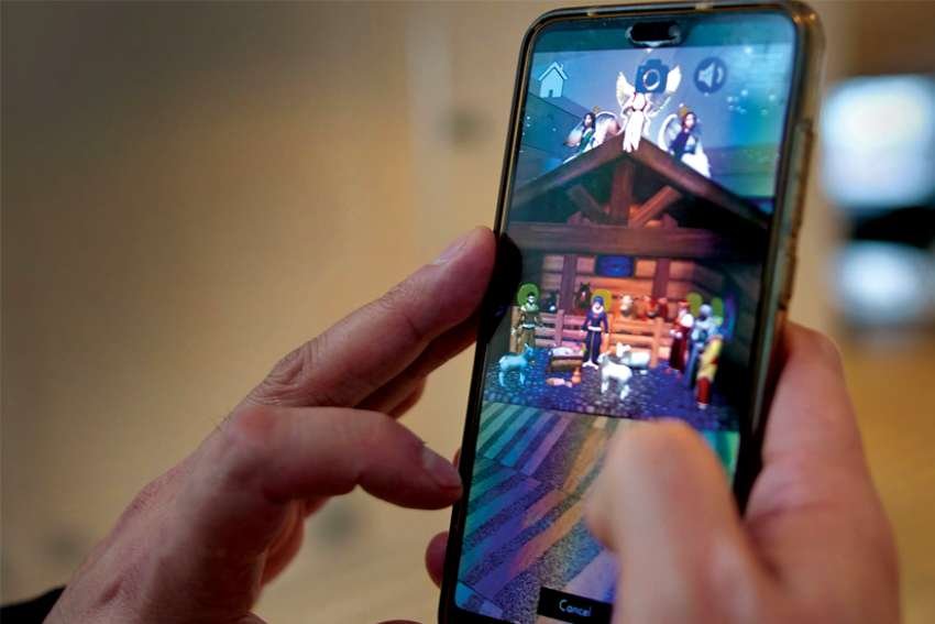 The City of Edmonton Augmented Reality app is an interactive digital Nativity scene, created by digital media students at NAIT, accessed on a smartphone.