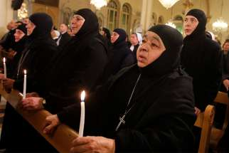 Women religious, who were freed after being held by rebels for more than three months, attend a 2014 prayer service at Holy Cross Church in Damascus, Syria, after their release.