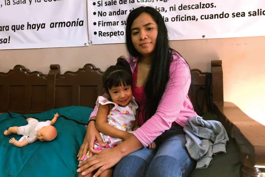 Denia Garcia poses with her daughter Diana, 2, at the Catholic-run Dignified Migrant shelter in Piedras Negras, Mexico. Garcia wants to apply for asylum in the United States, but faces a weeks-long wait. The Dignified Border shelter is short on space to host asylum-seekers.