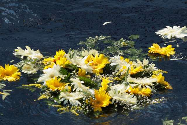 A wreath of flowers thrown by Pope Francis floats in the Mediterranean Sea in the waters off the Italian island of Lampedusa in this July 8, 2013, file photo. The pope threw a wreath to honor the memory of immigrants who have died trying to cross from Af rica to reach a new life in Europe. Marking the first anniversary of his Lampedusa visit, the pope said the the tragic deaths of thousands searching for a better future should trigger compassion and action, not indifference.