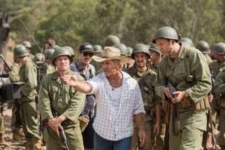 "Director Mel Gibson, center, is seen on the set of ""Hacksaw Ridge."" The movie marks Gibson's return to the director's chair after a 10-year absence."