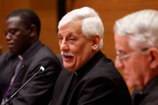 Jesuit Father Arturo Sosa Abascal, the new superior general of the Jesuits, speaks at a press conference in Rome Oct. 18. Also pictured are Jesuit Father Patrick Mulemi, director of the Jesuits' Rome communications office, and Jesuit Father Federico Lombardi, former Vatican spokesman.