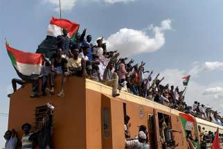 People in Khartoum, Sudan, ride on the train Aug. 17, 2019, to join the celebrations of the signing of the Sudan's new power-sharing agreement. Catholic bishops in South Sudan praised the recent peace agreement for neighboring Sudan, which has experienced political turmoil since April.