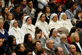 Nuns and others attend Pope Francis' general audience in Paul VI hall at the Vatican Nov. 30.