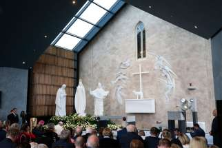 Pope Francis is pictured in a file photo praying as he visits the Chapel of the Apparitions at the Knock Shrine in Knock, Ireland. Because of the COVID pandemic, the Marian shrine has announced it will close Aug. 14-16 to discourage pilgrims from coming for the feast of the Assumption, usually its busiest day of the year.