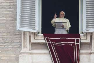 Pope Francis leads the Angelus from the window of his studio overlooking St. Peter's Square Oct. 22 at the Vatican.